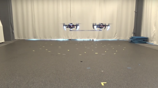 two drones flying in sync